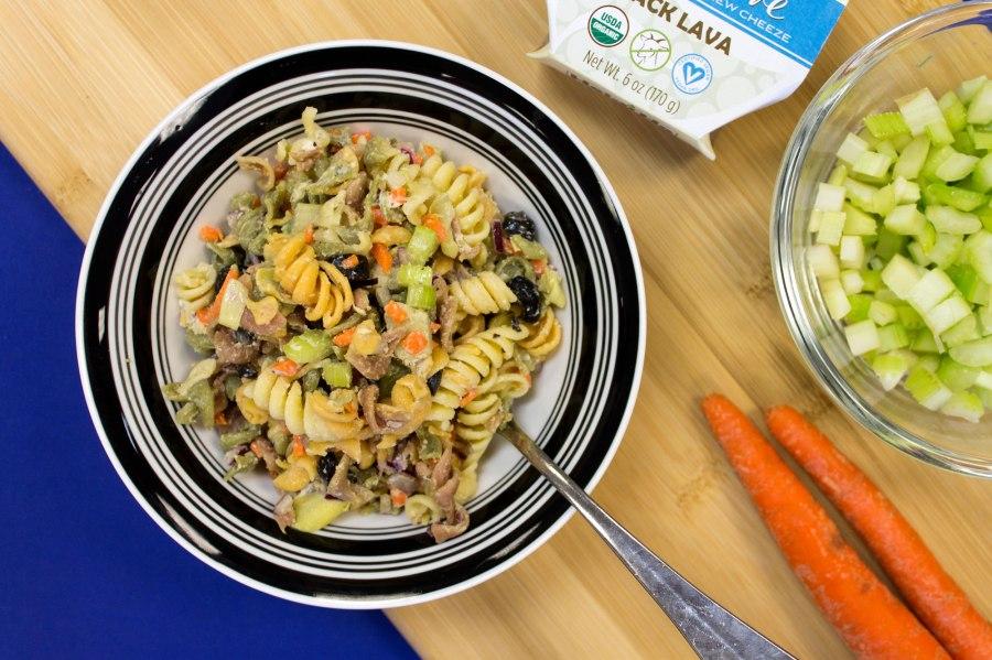 Summer pasta salad with artichoke hearts and Black Lava NeChèvre